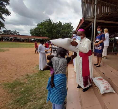 Archbishop during his giving of palliatives in cushioning the hunger effects of Coronavirus_2