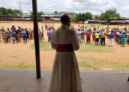Archbishop during his giving of palliatives in cushioning the hunger effects of Coronavirus_4