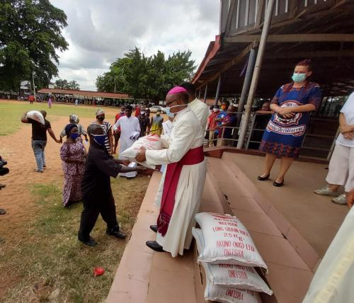 Archbishop during his giving of palliatives in cushioning the hunger effects of Coronavirus